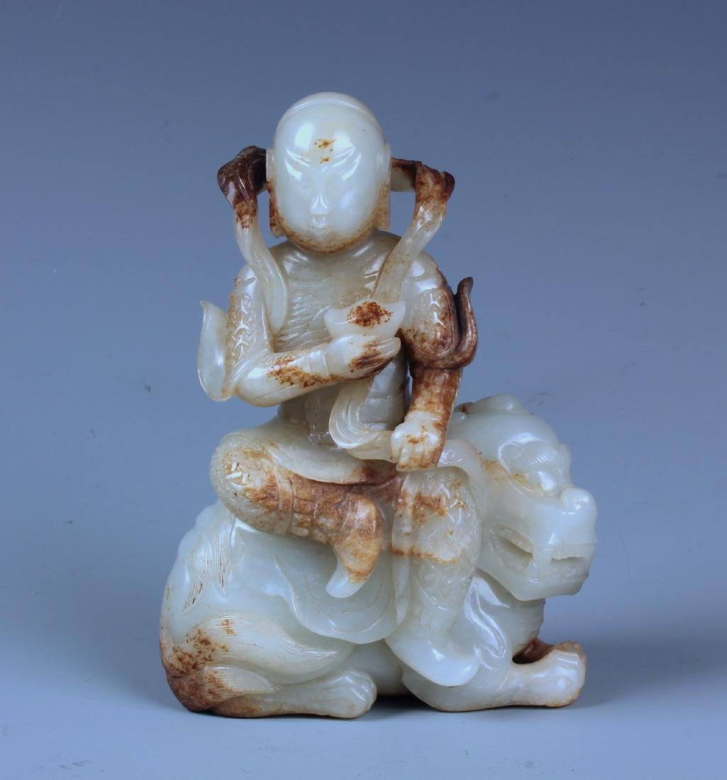 A FINELY CARVED CHINESE WHITE AND RUSSET JADE