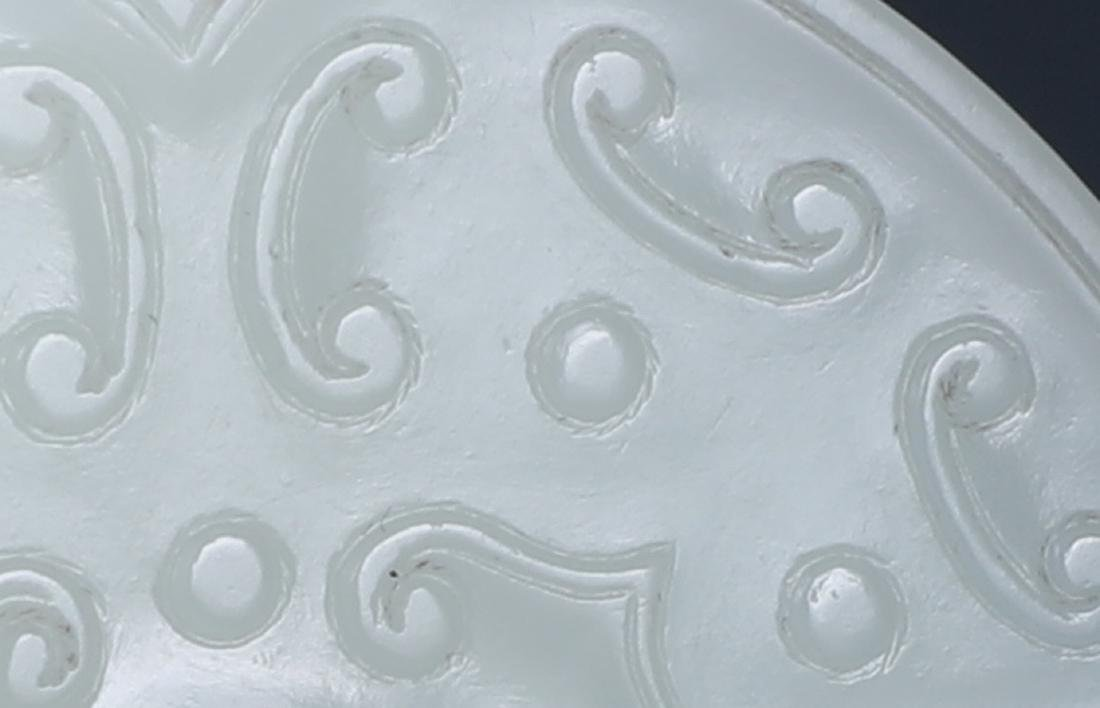 A FINELY CARVED CHINESE WHITE JADE 'DRAGON' BI - 2
