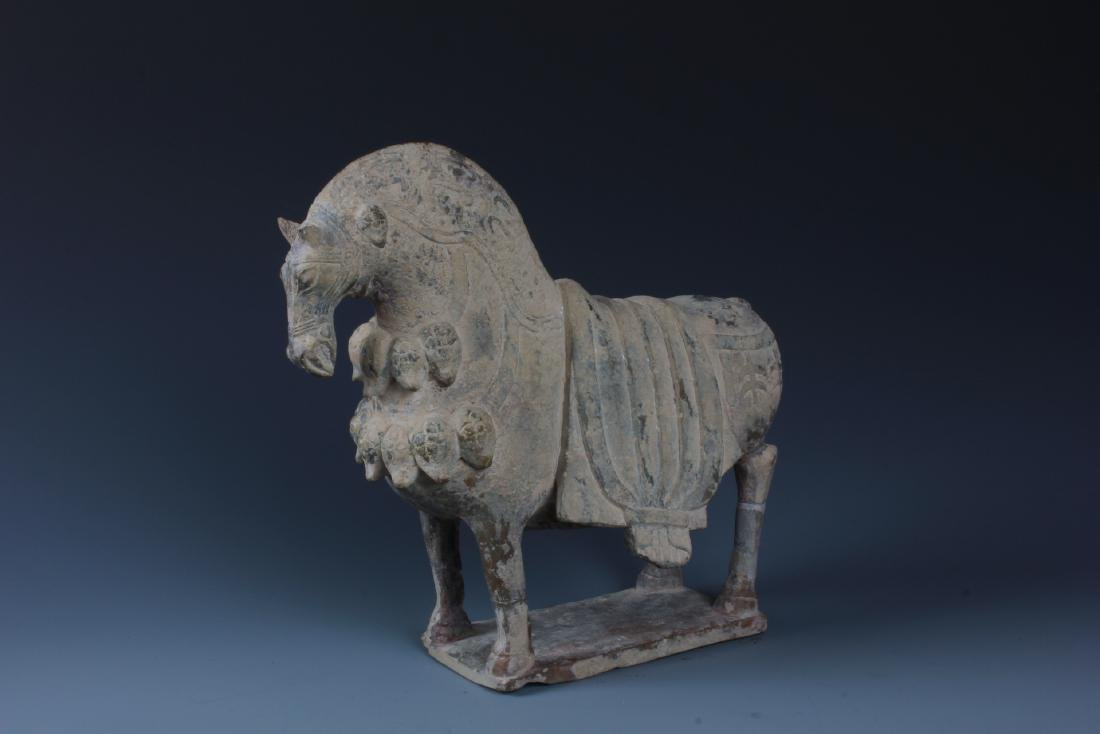 A FINELY CARVED CHINESE STONE FIGURE OF HORSE