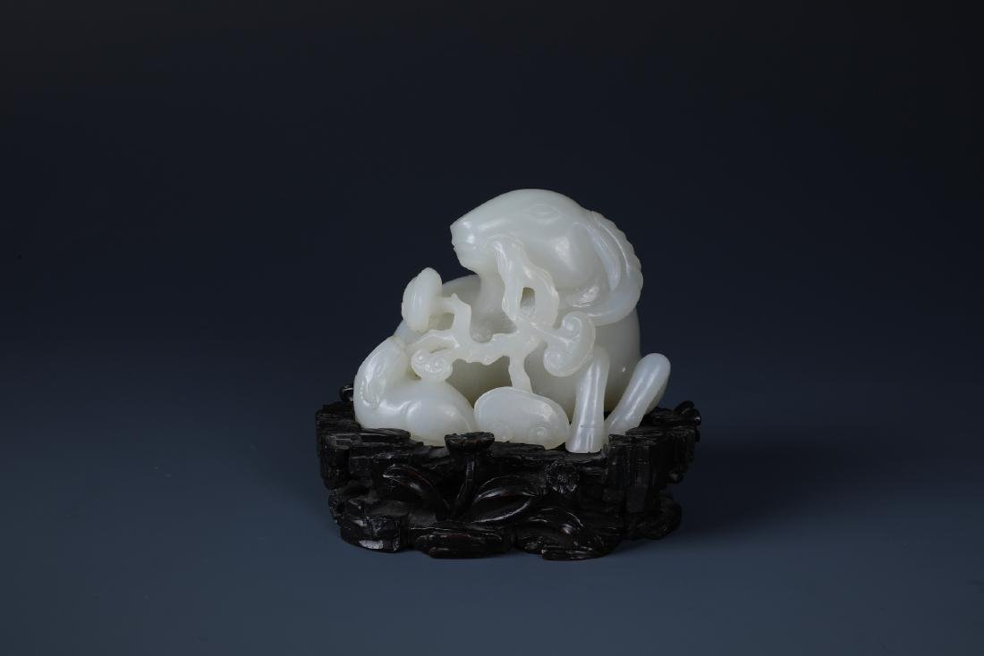 A FINELY CARVED CHINESE WHITE JADE GOAT