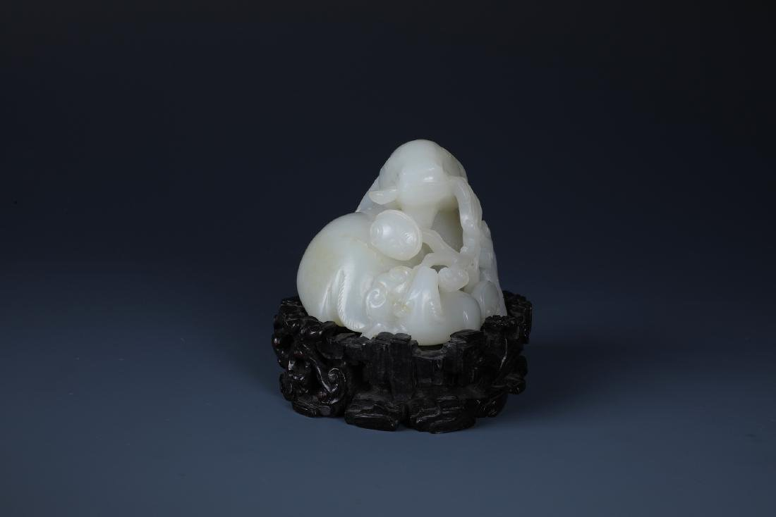 A FINELY CARVED CHINESE WHITE JADE GOAT - 2