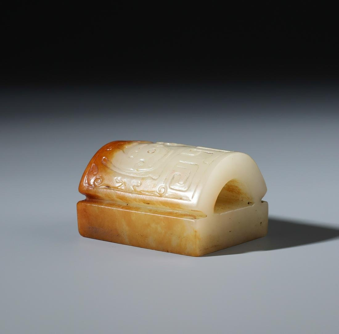A Chinese Carved White and Russet Jade Arched Seal