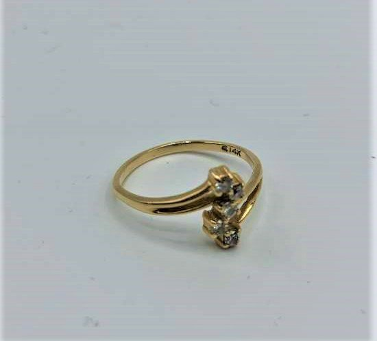 14 K Yellow Gold Ring with Four Diamonds
