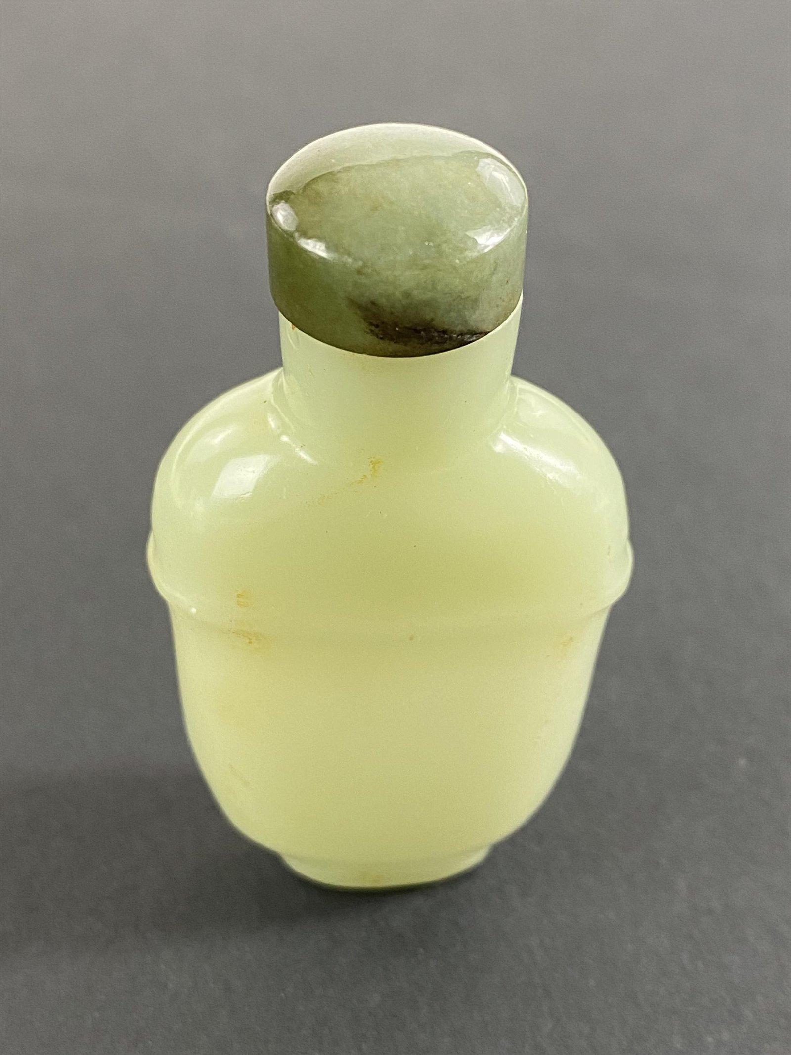 A Celadon Jade Chinese Diminutive Snuff Bottle