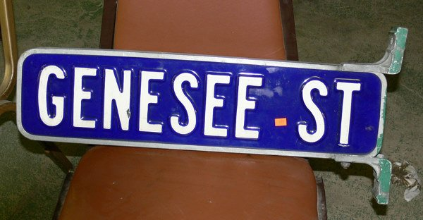 """1006: Genesee  St double sided tin sign 2 ft x 6 1/2"""""""