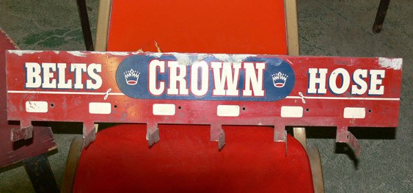 "1010: Belts Crown Hose rack tin 27"" x 5"""