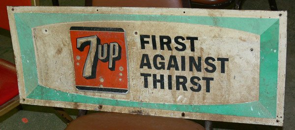 """1013: 7 up First Against Thirst  tin sign 30"""" x 13 3/4"""""""