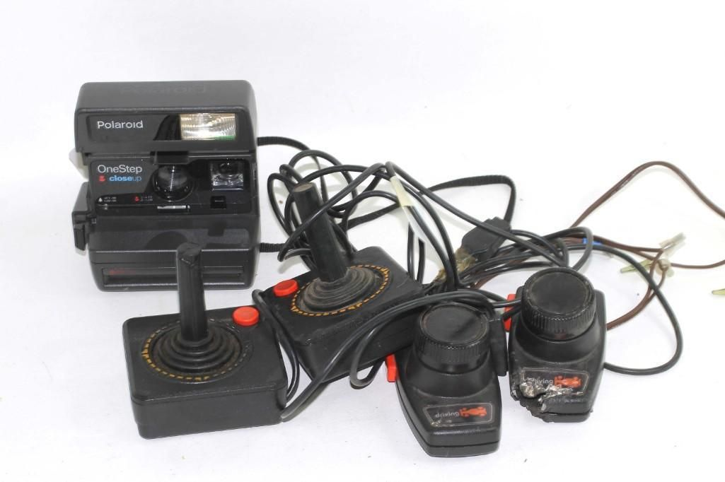 Atari Video Game Controllers and a Polaroid One Step