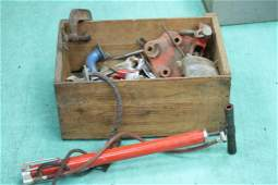 Large wooden crate full of old tools and a vintage bike