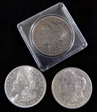 1886O Morgan Dollar and Two 1921P Morgan Dollars