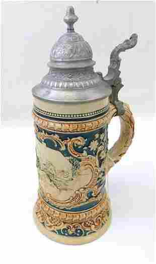 Antique Pottery Christmas Stein Featuring a Man Having