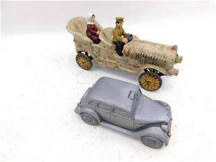 Large Cast Iron Car with 2 Plastic People and a Metal