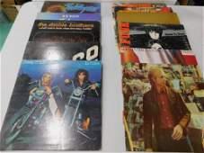 11 Vinyl Records incl Ted Nugent , ZZ Top , Doobie