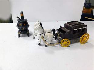 Vintage Cast Iron Stagecoach and a Cast Iron Potbelly
