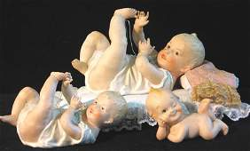 4060: Two German Bisque Piano Babies and a Lefton Kewpi