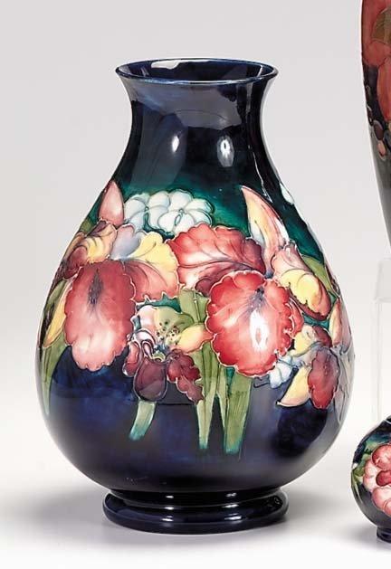 10663: Moorcroft 'Orchid' vase, , Of ovoid form, decora