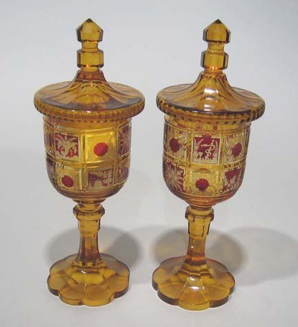 10665: Pair of Bohemian amber glass covered goblets, la