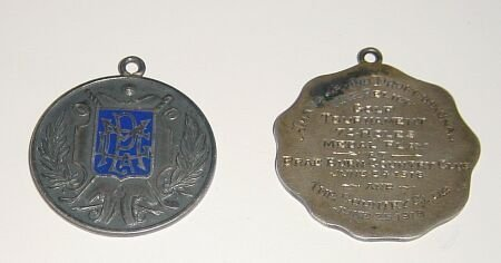 1005: An M.P.G.A. sterling silver and blue enamel medal