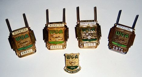 1009: A W.G.A. 1957 gilt metal and enamel bag clip