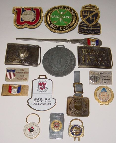 1015: Fourteen various money clips and badges etc.