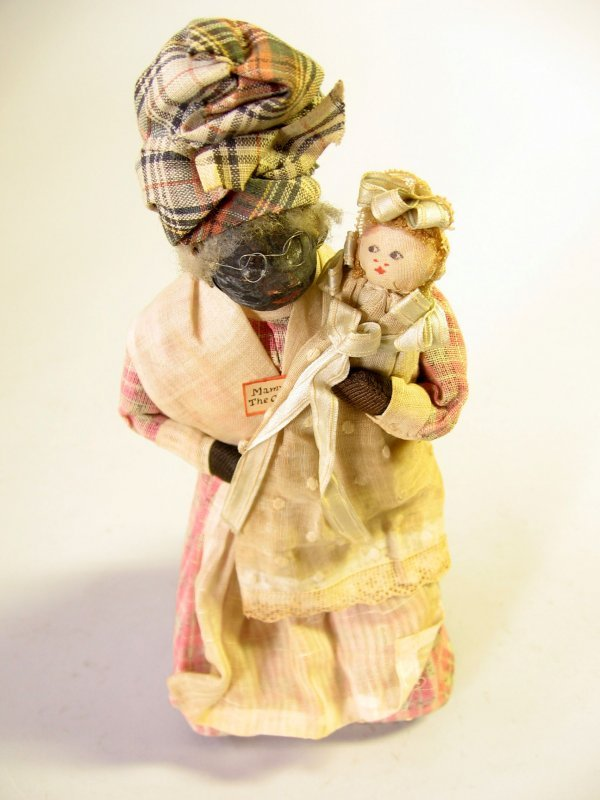 12: A handmade mammy doll with baby, late 19th/early 20