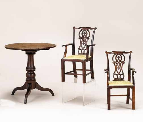 13A: Two miniature Chippendale armchairs and a candlest