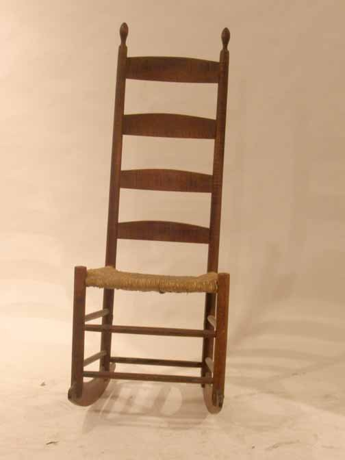 194: Tiger maple ladder back rocking chair., , Oval fin