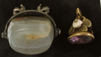 "2006: Silver plate and agate three sided"" carved wax se"