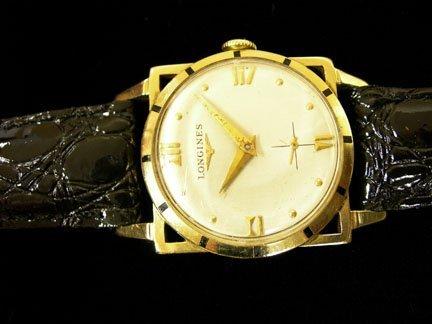 2175: Gentleman;s 14 karat yellow gold Longines wristwa