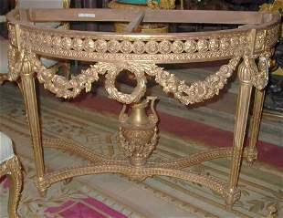 PAIR OF LOUIS XVI-STYLE GILTWOOD CONSOLES 20th c. E