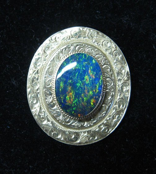 3009: 14k. Gold and Black Opal Pin, , The oval opal sto