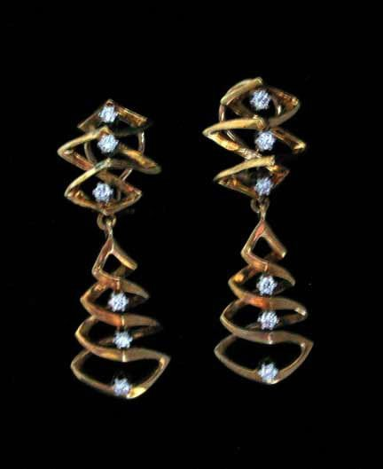 3022: Free Form gold and diamond tree design earrings,