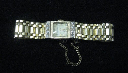 3024: Lady's gold Estrella wristwatch, , 14 Karat yello