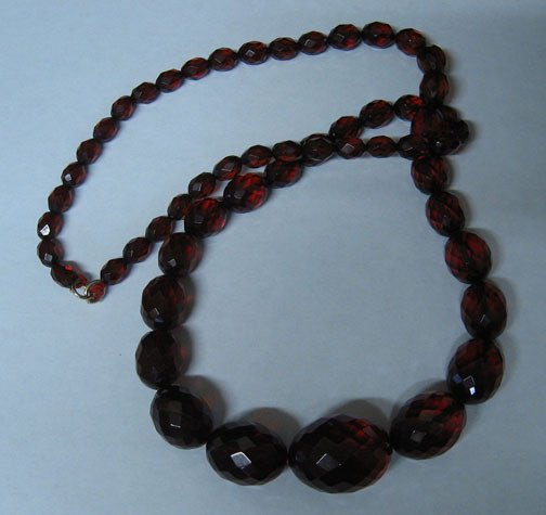 4011: Cherry Amber and Plastic Bead Necklace, Including