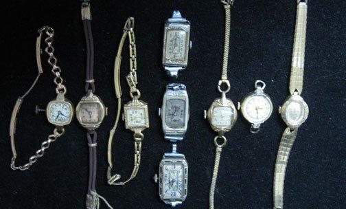 4020: Nine piece Gold Case Lady's Watch Movements, Comp