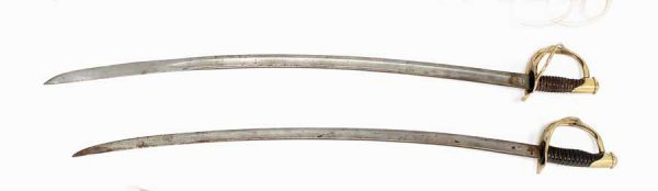 5: Two Civil War sabres, one marked P.S. Justice, Phila