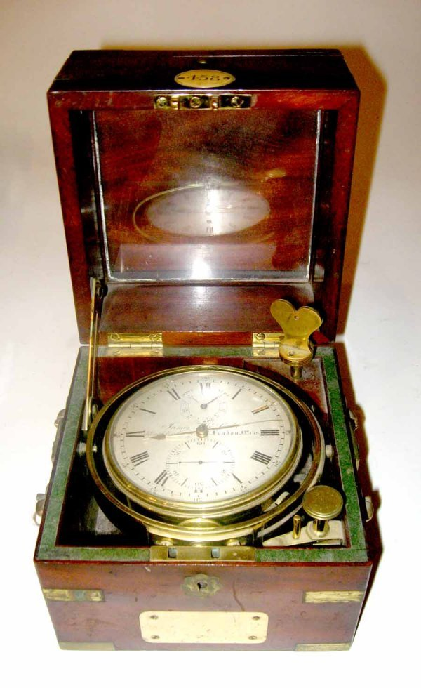 65: Wood cased and gimbaled ship's chronometer, james m