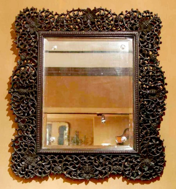 17: An Anglo-Colonial carved hardwood wall mirror