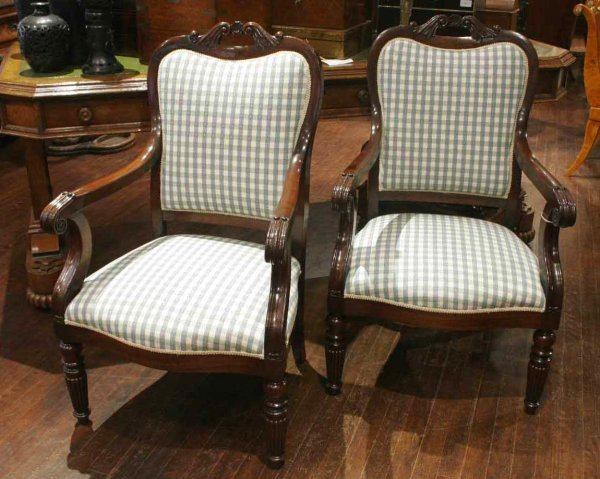 25: A pair of Victorian mahogany armchairs