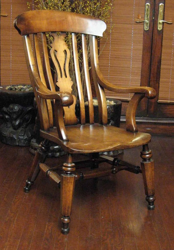 533: A provincial George II style elm armchair