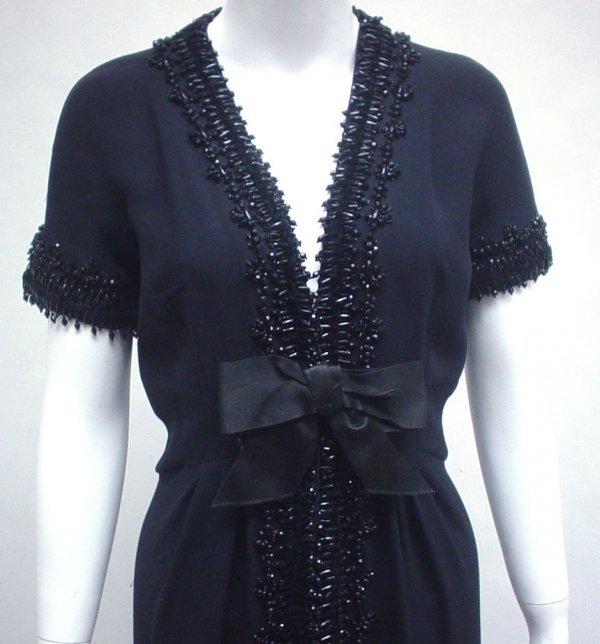 1004: Elizabeth Arden black crepe beaded evening gown