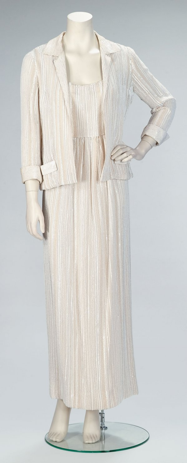 1021: Guy Laroche white beaded evening gown and jacket,