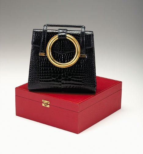 1253: Fine Cartier black alligator purse in fitted case