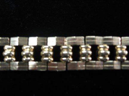 1365: 14 karat yellow gold flexible bracelet, 20th cent