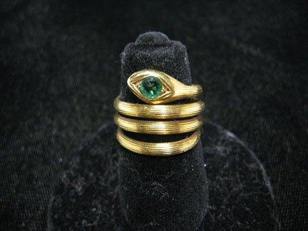1371: E. Zolotas snake form ring, , 18 karat yellow gol