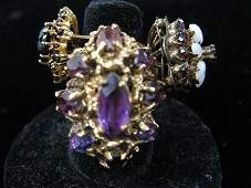 1518 Three yellow gold rings set with amethysts garne