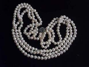 CULTURED PEARL TRIPLE STRAND NECKLACE 20th c. Wit