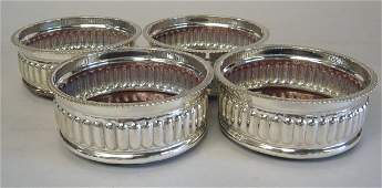 1105: Set of four silver plate wine coasters, , Each wi