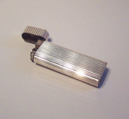 3: A SILVER CASE POCKET LIGHTER