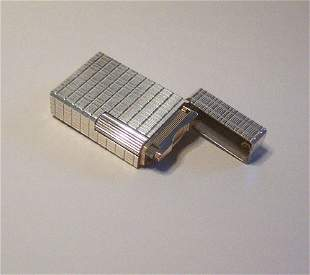 A SILVER PLATED DUPONT POCKET LIGHTER WITH